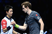 Kei Nishikori of Japan shakes hands at the net after his straight sets victory against Andy Murray during their round robin match during the Barclays...