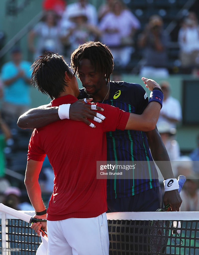 Kei Nishikori of Japan shakes hands at the net after his three set victory against Gael Monfils of France in their quarter final match during the...