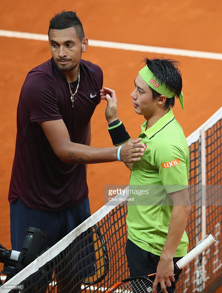 <a gi-track='captionPersonalityLinkClicked' href=/galleries/search?phrase=Kei+Nishikori&family=editorial&specificpeople=4432498 ng-click='$event.stopPropagation()'>Kei Nishikori</a> of Japan shakes hands at the net after his three set victory against Nick Kyrgios of Australia in their quarter final round match during day seven of the Mutua Madrid Open tennis tournament at the Caja Magica on May 06, 2016 in Madrid,Spain.