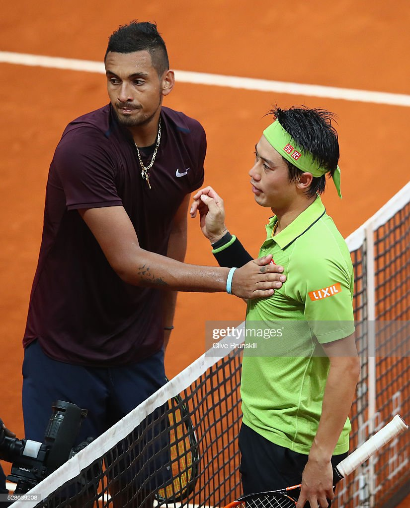 Kei Nishikori of Japan shakes hands at the net after his three set victory against Nick Kyrgios of Australia in their quarter final round match during day seven of the Mutua Madrid Open tennis tournament at the Caja Magica on May 06, 2016 in Madrid,Spain.