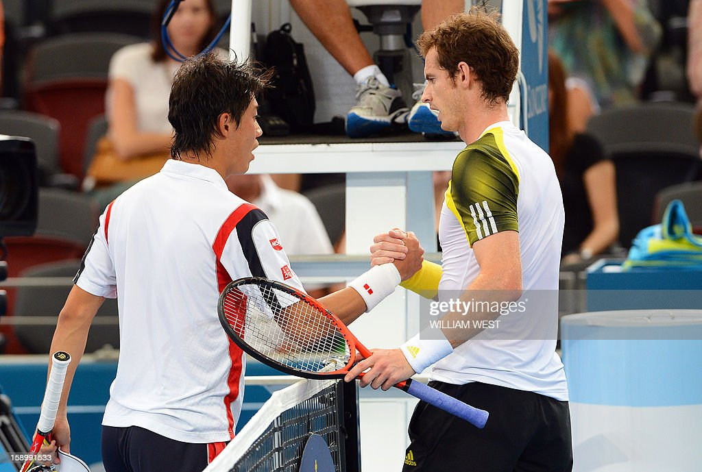 Kei Nishikori of Japan (L) shakes hands with Andy Murray of Britain (R) after retiring injured from their semi-final match at the Brisbane International tennis tournament on January 5, 2013. AFP PHOTO/William WEST USE