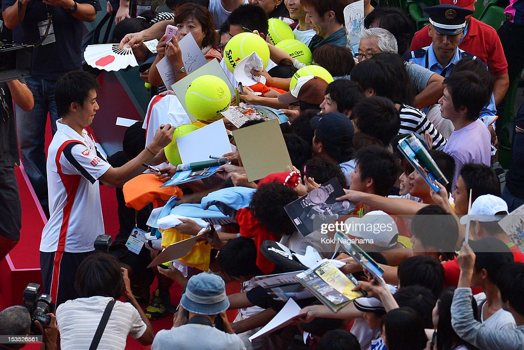 Kei Nishikori of Japan signs autographs after his men's singles semi final match against Marcos Baghdatis of Cyprus during day six of the Rakuten Open at Ariake Colosseum on October 6, 2012 in Tokyo, Japan.