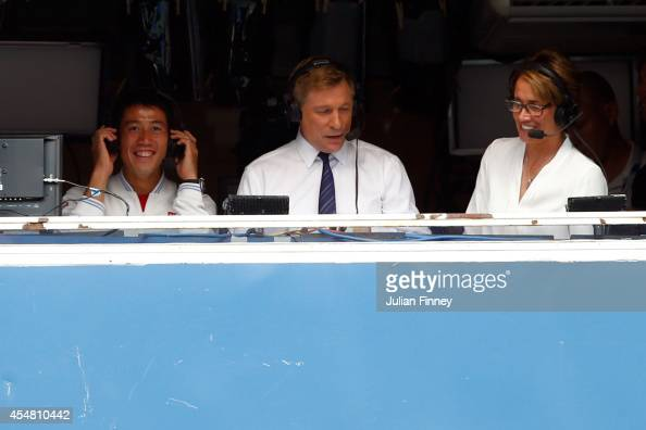 Kei Nishikori of Japan speaks to the CBS announcers after defeating Novak Djokovic of Serbia in their men's singles semifinal match on Day Thirteen...
