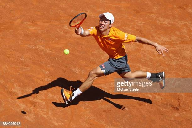Kei Nishikori of Japan stretches for a return during his second round match against David Ferrer of Spain on Day Four of The Internazionali BNL...