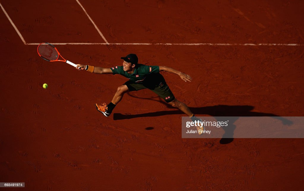 Kei Nishikori of Japan stretches for the ball during mens singles quarter finals match against Andy Murray of Great Britain on day eleven of the 2017 French Open at Roland Garros on June 7, 2017 in Paris, France.