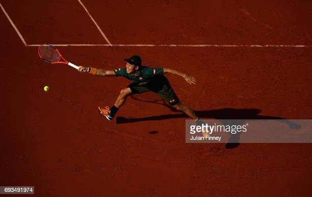 Kei Nishikori of Japan stretches for the ball during mens singles quarter finals match against Andy Murray of Great Britain on day eleven of the 2017...