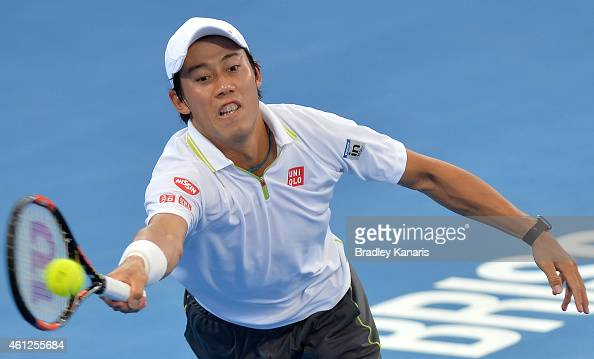 Kei Nishikori of Japan stretches out to play a forehand in the Men's semi final match against Milos Raonic of Canada during day seven of the 2015...