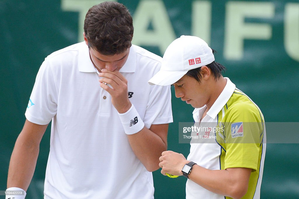 <a gi-track='captionPersonalityLinkClicked' href=/galleries/search?phrase=Kei+Nishikori&family=editorial&specificpeople=4432498 ng-click='$event.stopPropagation()'>Kei Nishikori</a> (R) of Japan talks to his doubles match partner <a gi-track='captionPersonalityLinkClicked' href=/galleries/search?phrase=Milos+Raonic&family=editorial&specificpeople=5421226 ng-click='$event.stopPropagation()'>Milos Raonic</a> of Canada in their match against Philipp Kohlschreiber of Germany and Mikhail Youzhny of Russia during day four of the Gerry Weber Open at Gerry Weber Stadium on June 13, 2013 in Halle, Germany.