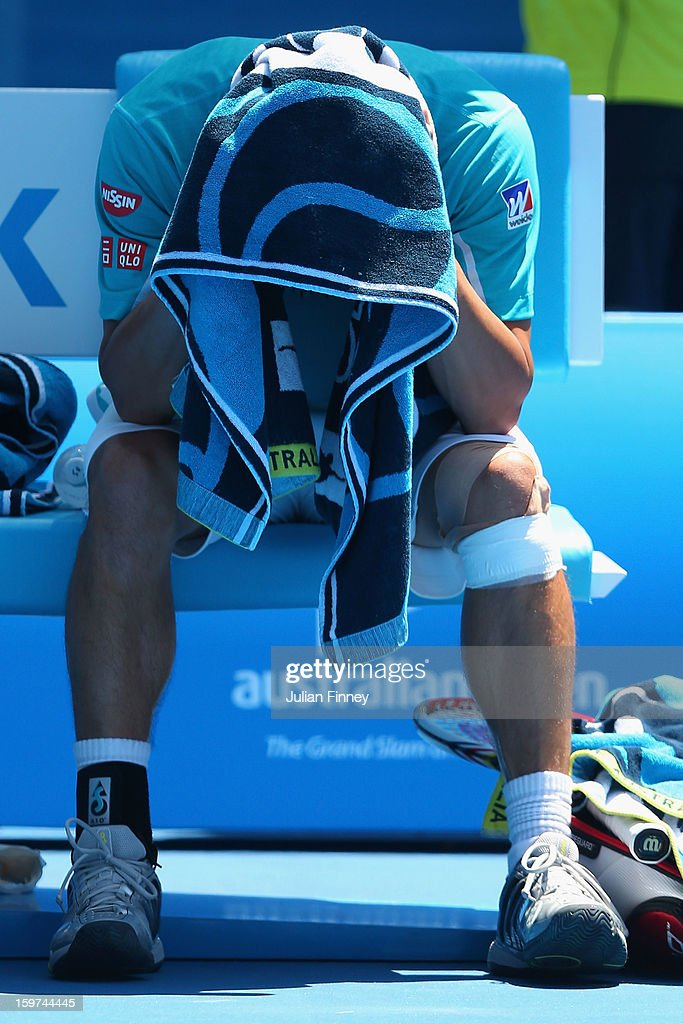 Kei Nishikori of Japan towels down in his fourth round match against David Ferrer of of Spain during day seven of the 2013 Australian Open at Melbourne Park on January 20, 2013 in Melbourne, Australia.