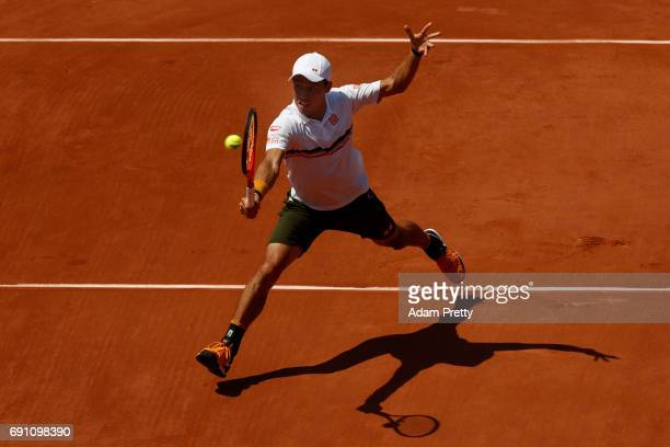 Kei Nishikori of Japan volleys during the men's singles second round match against Jeremy Chardy of France on day five of the 2017 French Open at...