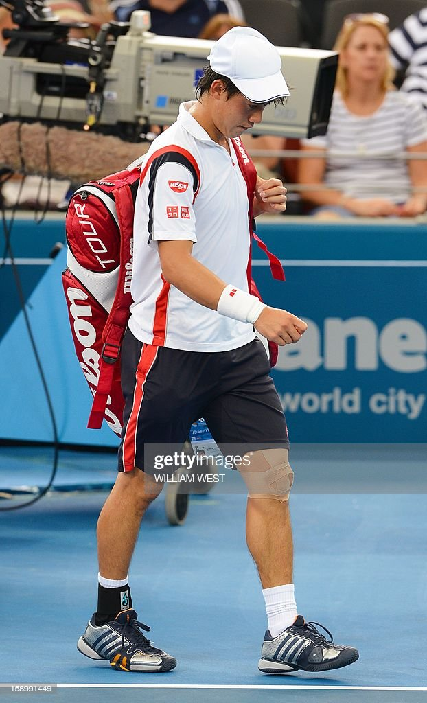 Kei Nishikori of Japan walks off after retiring injured in his semi-final match against Andy Murray of Britain at the Brisbane International tennis tournament on January 5, 2013. AFP PHOTO/William WEST USE