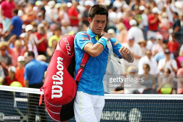 Kei Nishikori of Japan walks off of the court after losing against Benoit Paire of France during their Men's Single First Round match on Day One of...