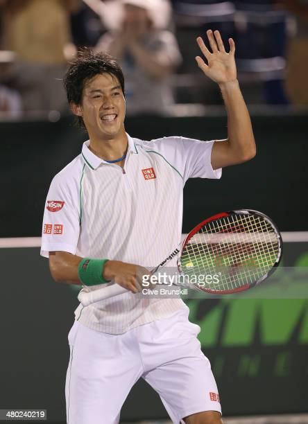 Kei Nishikori of Japan waves to the crowd after his straight sets victory against Grigor Dimitrov of Bulgaria during their third round match during...