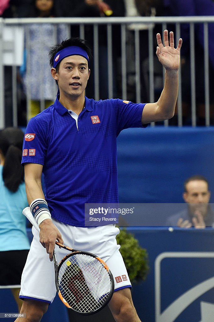 Kei Nishikori of Japan waves to the crowd following a victory over Sam Querrey of the United States in their semifinals singles match at the Racquet...