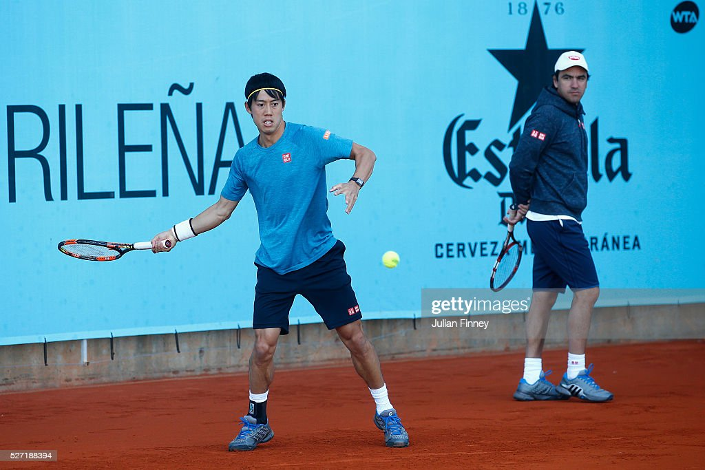 <a gi-track='captionPersonalityLinkClicked' href=/galleries/search?phrase=Kei+Nishikori&family=editorial&specificpeople=4432498 ng-click='$event.stopPropagation()'>Kei Nishikori</a> of Japan with Dante Bottini on the practice court during day three of the Mutua Madrid Open tennis tournament at the Caja Magica on May 02, 2016 in Madrid, Spain.
