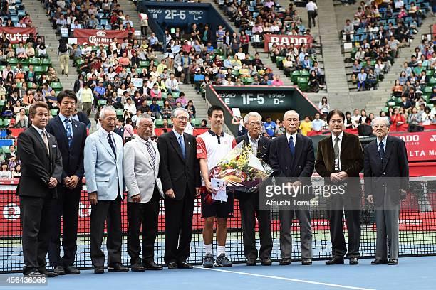 Kei Nishikori poses with Japanese tennis legends Ryuzo Tsujino Syuzo Matsuoka Koji Watanabe Isao Watanabe Nobuo Kuroyanagi Michio Fujii Ichizo...