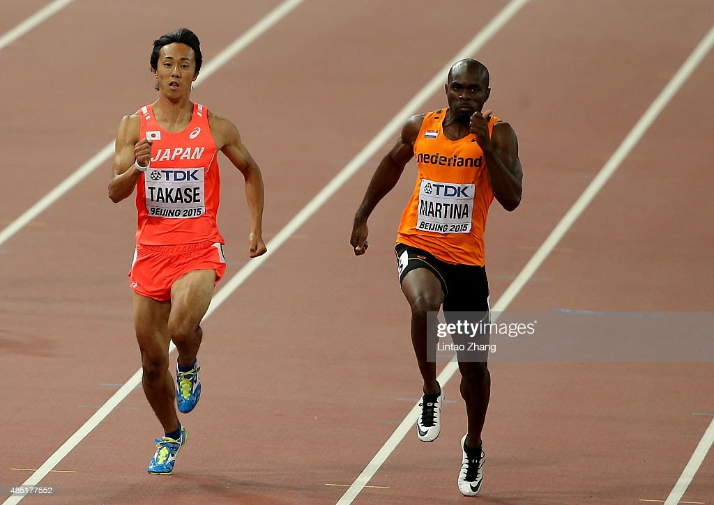 Kei Takase of Japan and Churandy Martina of the Netherlands compete in the Men's 200 metres heats during day four of the 15th IAAF World Athletics...