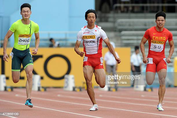 Kei Takase Peimeng Zhang and Bingtian Su compete in the M100m during the Seiko Golden Grand Prix Tokyo 2015 at Todoroki Stadium on May 10 2015 in...