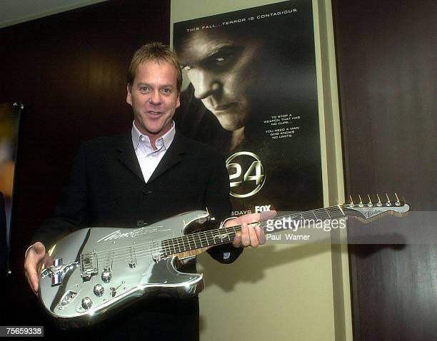 Keifer Sutherland is presented with a Fender Mustang Stratocastor guitar