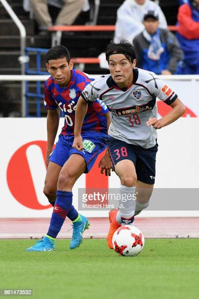 Keigo Higashi of FC Tokyo and Dudu of Ventforet Kofu compete for the ball during the JLeague J1 match between Ventforet Kofu and FC Tokyo at...