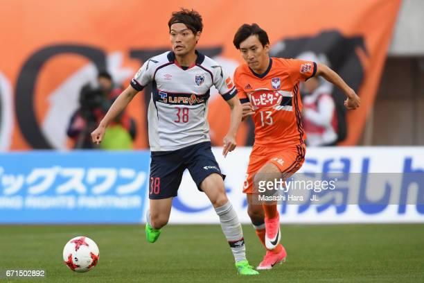 Keigo Higashi of FC Tokyo and Masaru Kato of Albirex Niigata compete for the ball during the JLeague J1 match between Albirex Niigata and FC Tokyo at...