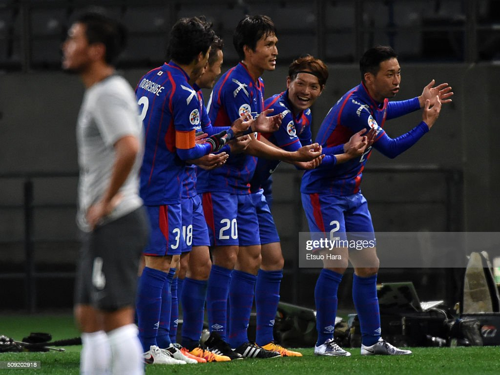 Keigo Higashi of FC Tokyo(R2) celebrates scoring his team's third goal during the AFC Champions League playoff round match between FC Tokyo and Chonburi FC at the Tokyo Stadium on February 9, 2016 in Chofu, Japan.