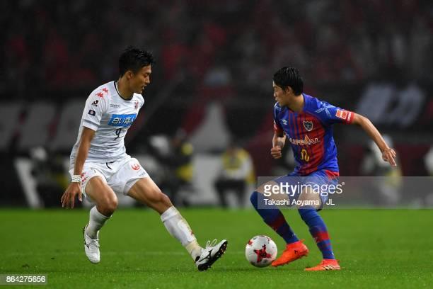 Keigo Higashi of FC Tokyo takes on Ken Tokura of Consadole Sapporo during the JLeague J1 match between FC Tokyo and Consadole Sapporo at Ajinomoto...