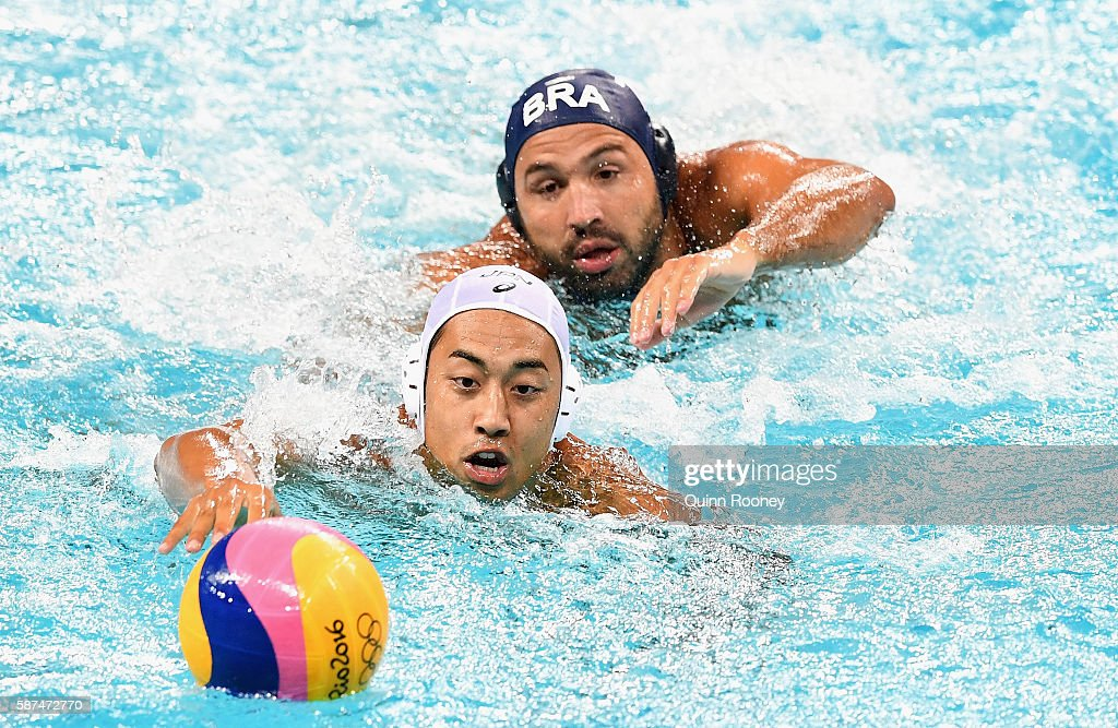 Keigo Okawa of Japan and Felipe Perrone of Brazil compete for the ball during the Men's Prelimimary Round Group B match between Japan and Brazil on Day 3 of the Rio 2016 Olympic Games at Maria Lenk Aquatics Centre on August 8, 2016 in Rio de Janeiro, Brazil.