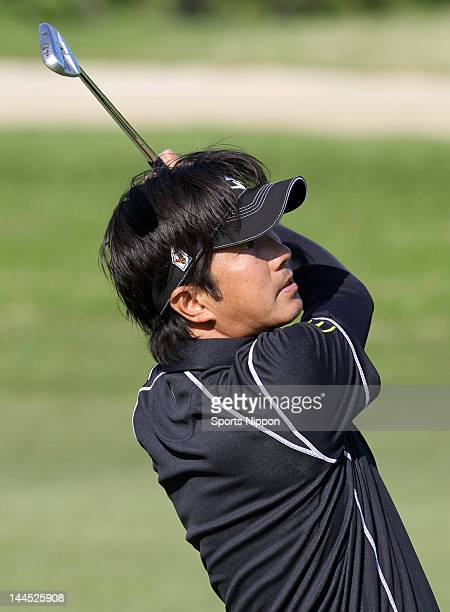 Keiichiro Fukabori hits a second shot on the 13th hole during the third round of the PGA Championship Nissin Cupnoodles Cup 2012 at Karasuyamajo...