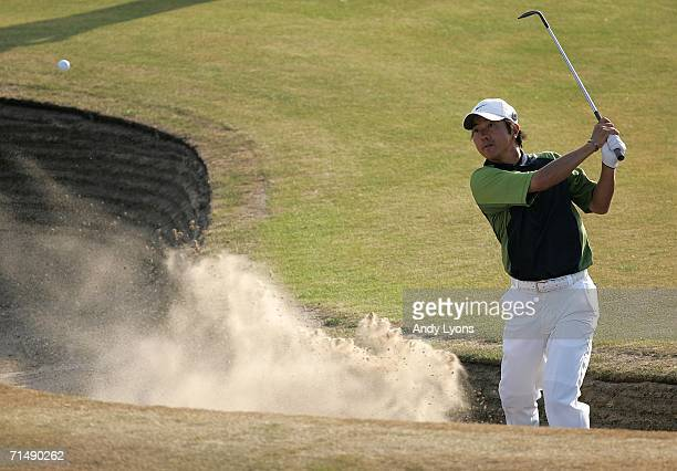Keiichiro Fukabori of Japan hits out of a bunker on the 18th hole during the first round of The Open Championship at Royal Liverpool Golf Club on...