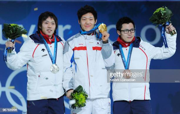 Keiichiro Nagashima of Japan celebrates winning the silver medal Mo TaeBum of South Korea gold and Joji Kato of Japan bronze during the medal...