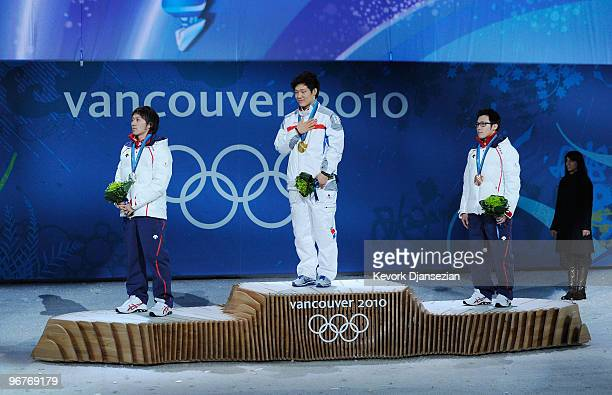 Keiichiro Nagashima of Japan celebrates winning the silver medal Mo TaeBum of South Korea gold and Joji Kato of Japan bronze as they stand for the...