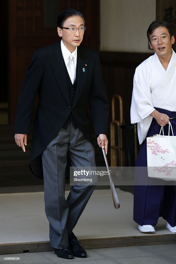 <a gi-track='captionPersonalityLinkClicked' href=/galleries/search?phrase=Keiji+Furuya&family=editorial&specificpeople=10094135 ng-click='$event.stopPropagation()'>Keiji Furuya</a>, Japan's chairman of the National Public Safety Commission, leaves the Yasukuni Shrine in Tokyo, Japan, on Friday, Aug. 15, 2014. Japanese Prime Minister Shinzo Abe stayed away from the Tokyo war shrine on the 69th anniversary of Japan's World War II defeat today, instead sending a donation as he seeks a summit with Chinese President Xi Jinping. Photographer: Kiyoshi Ota/Bloomberg via Getty Images