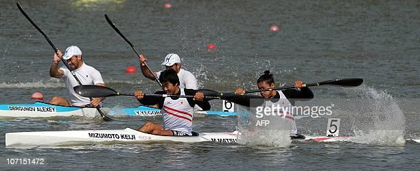 Keiji Mizumoto and Momotaro Matsushita of Japan and Sergey Borzov and Aleksey Babadjanov of Uzbekistan compete in the men's kayak double 200m final...