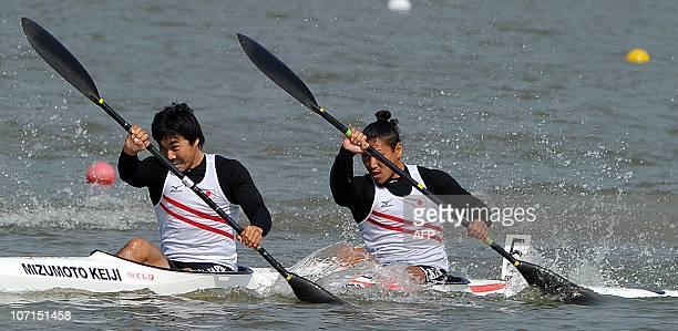 Keiji Mizumoto and Momotaro Matsushita of Japan competes in the men's kayak double 200m final at the 16th Asian Games in Guangzhou on November 26...