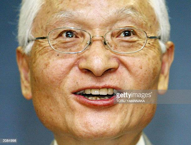 Keiji Tachikawa president of leading Japanese mobile phone carrier NTT DoCoMo Inc smiles as he answers questions during a press conference in Tokyo...