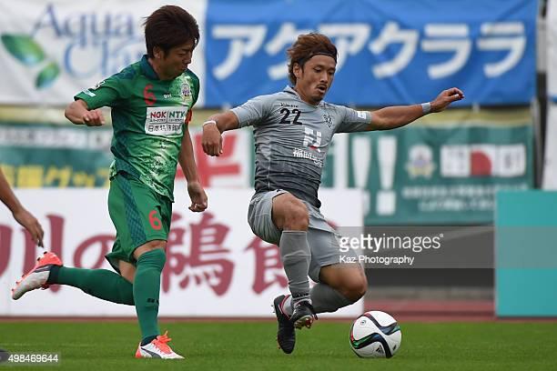 Keiji Takachi of FC Gifu and Hokuto Nakamura compete for the ball during the football match between FC Gifu and Avispa Fukuoka at Nagaragawa Stadium...