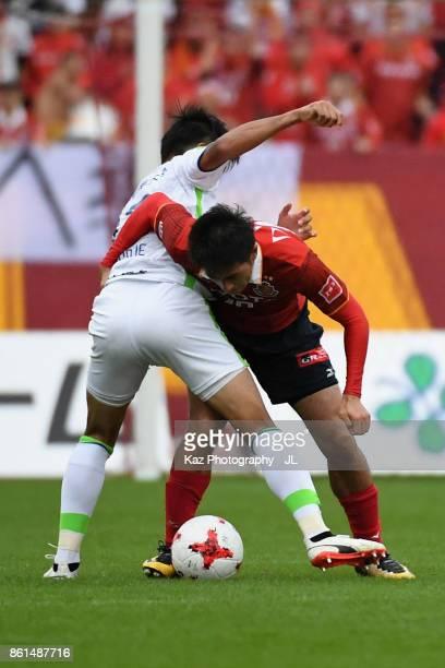 Keiji Tamada of Nagoya Grampus and Miki Yamane of Shonan Bellmare compete for the ball during the JLeague J2 match between Nagoya Grampus and Shonan...