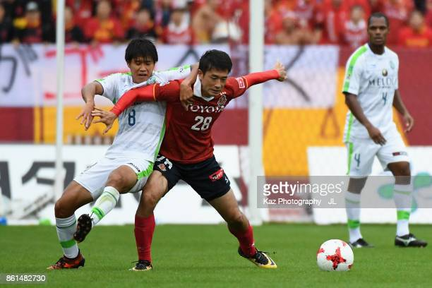 Keiji Tamada of Nagoya Grampus and Naoki Yamada of Shonan Bellmare compete for the ball during the JLeague J2 match between Nagoya Grampus and Shonan...