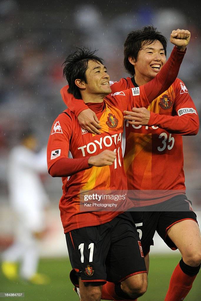Keiji Tamada (L) of Nagoya Grampus celebrates scoring the first goal with his teammate Teruki Tanaka during the J.League Yamazaki Nabisco Cup match between Nagoya Grampus and Cerezo Osaka at Mizuho Stadium on March 20, 2013 in Nagoya, Aichi, Japan.