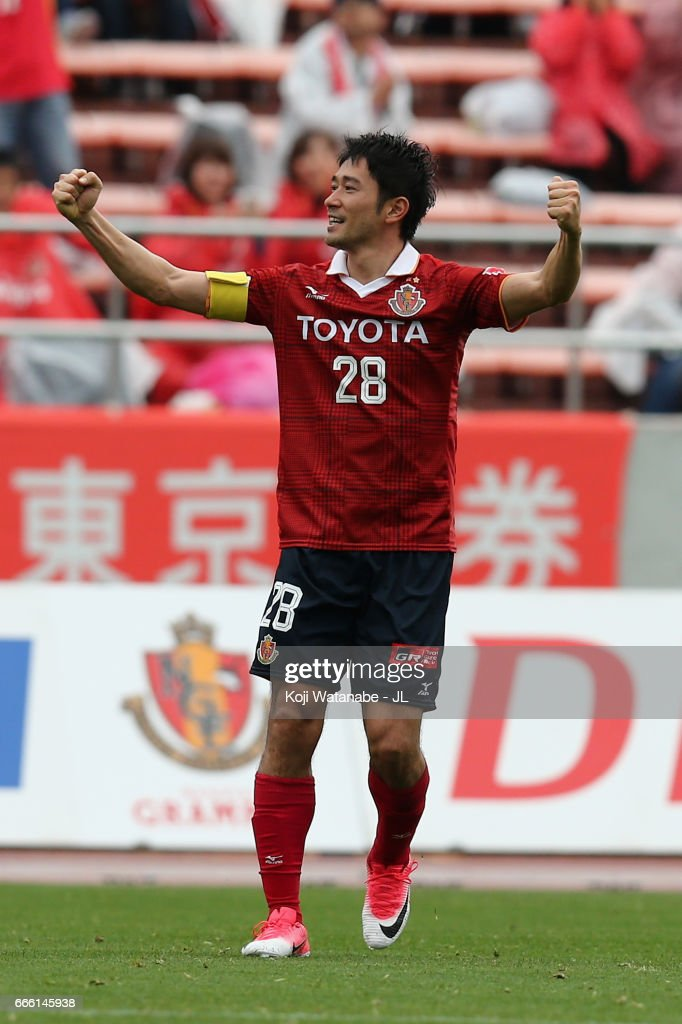 Keiji Tamada of Nagoya Grampus celebrates scoring the opening goal from a free kick during the J.League J2 match between Nagoya Grampus and Kamatamare Sanuki at Paroma Mizuho Stadium on April 8, 2017 in Nagoya, Aichi, Japan.