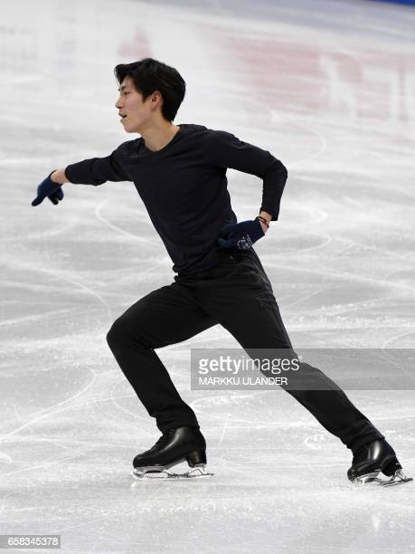 Keiji Tanaka of Japan performs during practice ahead of the ISU World Figure Skating Championships in Helsinki Finland on March 27 2017 / AFP PHOTO /...