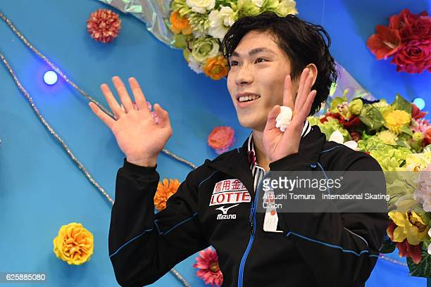 Keiji Tanaka of Japan smiles in the kiss and cry after skating in the Men free skating during the ISU Grand Prix of Figure Skating NHK Trophy on...