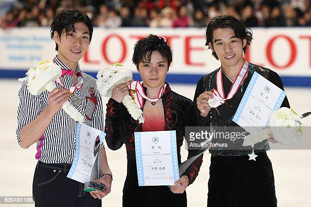 Keiji Tanaka Shoma Uno and Takahiro Mura of Japan pose with their medals during the Japan Figure Skating Championships 2016 on December 24 2016 in...