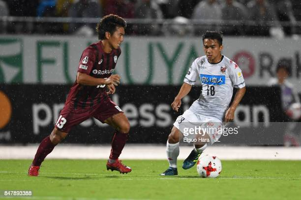 Keijiro Ogawa of Vissel Kobe and Chanathip Songkrasin of Consadole Sappporo compete for the ball during the JLeague J1 match between Vissel Kobe and...