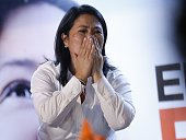 Keiko Fujimori of the Fuerza Popular party reacts during a brief appearance in front of supporters at her party's headquarters in a local hotel as...