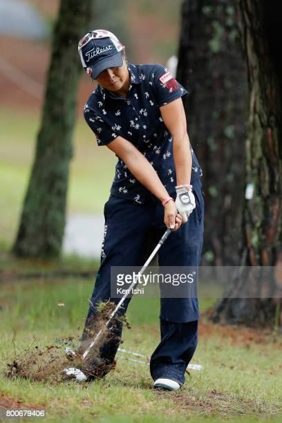 Keiko Sasaki of Japan hits a recovery shot on the 18th hole during the final round of the Yupiteru The Shizuoka Shimbun SBS Ladies at the Shizuoka...