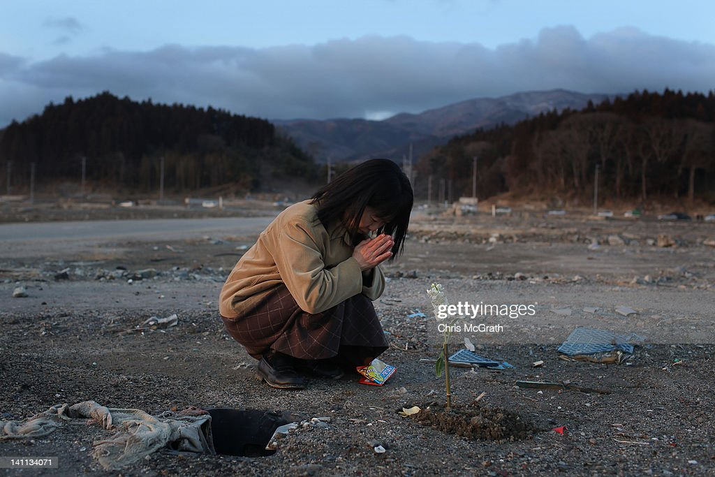 Keiko Suzuki, 40 prays at the site of her uncle's home on March 11, 2012 in Rikuzentakata, Japan. Her uncle Kazuyoshi Sugawara was killed when his home was swept away by the tsunami last year. On the one year anniversary, the areas most affected by last year's March 11, 2011 earthquake and subsequent tsunami that left 15,848 dead and 3,305 missing according to Japan's National Police Agency, continue to struggle. Thousands of people still remain without homes living in temporary dwellings. The Japanese government faces an uphill battle with the need to dispose of rubble as it works to rebuild economies and livelihoods. Across the country people are taking part in ceremonies to pay respects to the people who lost their lives.