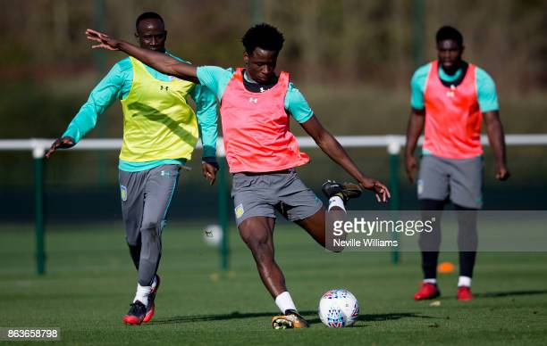 Keinan Davis of Aston Villa in action with team mate Micah Richards during a training session at the club's training ground at Bodymoor Heath on...