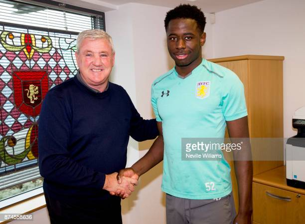 Keinan Davis of Aston Villa poses for a picture with Aston Villa manager Steve Bruce at the Aston Villa training ground on November 15 2017 in...